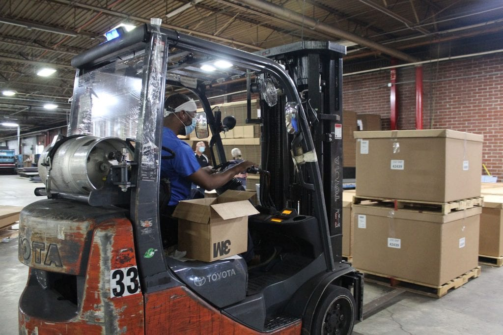 Man operating forklift in warehouse