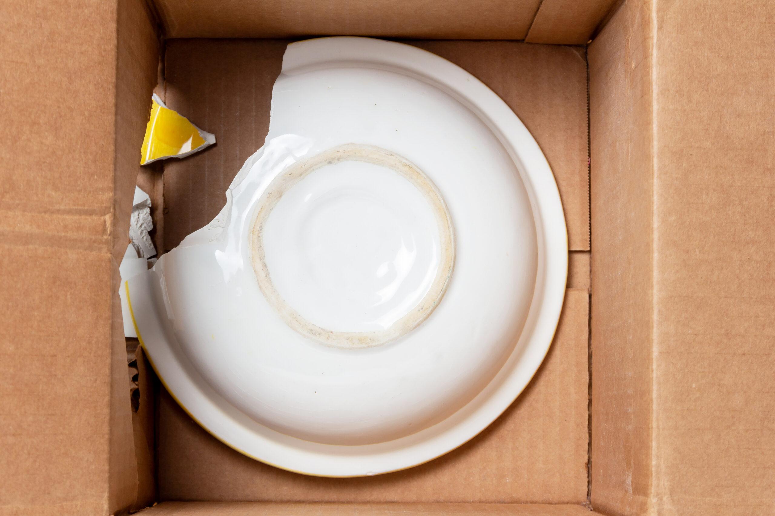 Broken plate inside box